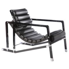 Eileen Grey's Transatchair, 1927, is box-shaped and has chrome-steel fasteners connecting the black-lacquered frame, Art Deco