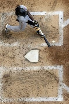 Pittsburgh Pirates' Andrew McCutchen hits a two-run home run during the fifth inning of a baseball game against the Milwaukee Brewers, Sunday, June 3, 2012, in Milwaukee.