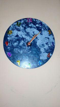 A moon wall clock made from Aluminam circle