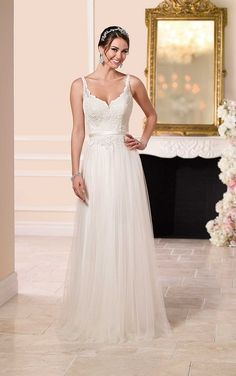 Stella York #6157 - This tulle sheath silhouette from the Stella York wedding dress collection features stunning lace detailing on the bodice and delicate straps, as well as a figure-flattering ribbon waist sash.