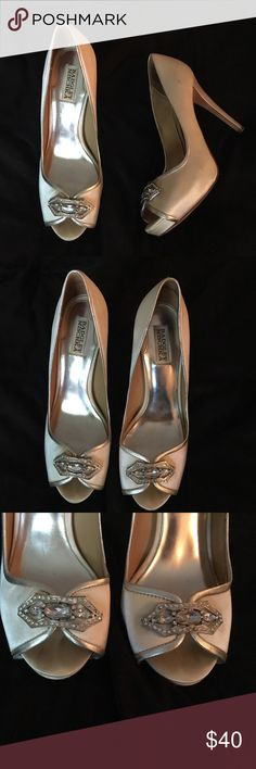 Badgley Mischka jeweled peep toe heels Gorgeous Peep toe pumps, with jeweled broach on the toe. Bought and worn for a wedding, and they were perfect! Various scuffs and marks on both shoes (pictured) but they take nothing away from the beauty of the shoe. Badgley Mischka Shoes Heels