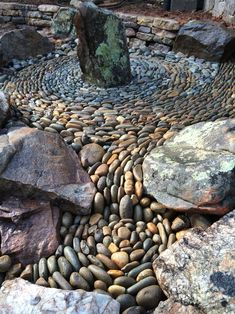 I love the way the pebbles have been arranged to mimic the look of flowing water.