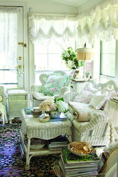 Small, enclosed porch with Victorian-style wicker.The Cottage Journal
