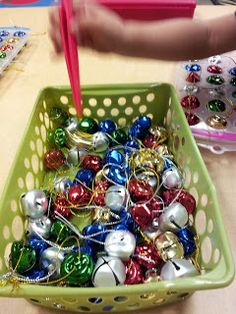 use tweezers to move jingle bells to an ice cube tray...can also make patterns, sort by color, etc