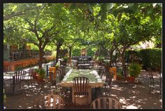 Long table set up in Travigne's courtyard in St Helena, CA.   Outdoor dining beside the bubbling fountain