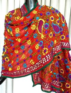 Gorgeous phulkari work georgette dupatta has been hand embroidered in a vibrant colored floral pattern, with wool thread and sequins - See more at: http://giftpiper.com/Handembroidered-Phulkari-Work-Georgette-Dupatta-Red-id-310602.html#sthash.bUlZsiG5.dpuf