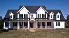 Elegant Farmhouse Home Plan - 92355MX | Country, Farmhouse, Traditional, Exclusive, Photo Gallery, 1st Floor Master Suite, Bonus Room, Butler Walk-in Pantry, CAD Available, Den-Office-Library-Study, In-Law Suite, Loft, Media-Game-Home Theater, PDF, Wrap Around Porch, Corner Lot, Sloping Lot | Architectural Designs