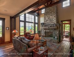Living stone construction. Beautiful wood floors, stone fireplace and lots of windows