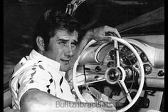 Robert Fuller sitting in his first car.