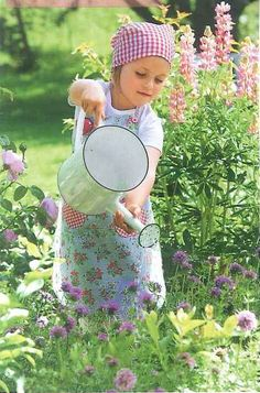 Girl watering the flowers****FOLLOW OUR UNIQUE GARDENING BOARDS AT www.pinterest.com/earthwormtec*****FOLLOW us on www.facebook.com/earthwormtec  www.google.com/+earthwormtechnologies for great organic gardening tips #children #garden