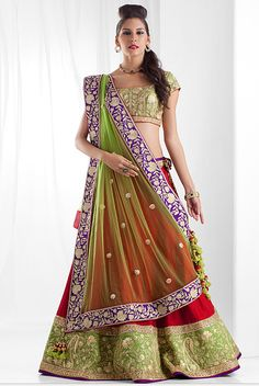 Cotton weaved ghagra with rawsilk border and blouse and net dupatta embellished with zari and dori work