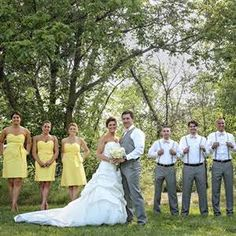 Sarah and Chris's wedding party looked both rustic yet elegant in short canary yellow dresses for the ladies and suspenders with bow ties for the groomsmen.