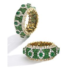 18 Karat Gold, Platinum, Emerald and Diamond Bracelet, Van Cleef & Arpels The bracelet of bombé form, set with 11 cushion-cut emeralds weighing approximately 21.00 carats, accented by round emeralds weighing approximately 36.75 carats, completed by round diamonds weighing approximately 58.00 carats, gross weight approximately 104 dwts, internal circumference 7½ inches, signed Van Cleef & Arpels, numbered NY 35563 and NY 59909, with French maker's mark; 1965.