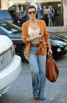 Kim Kardashian high waisted jeans belt white top camel orange brown cardigan sunglasses bag