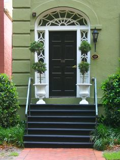 For @Ivory Schwaberow  Sage green house with black front door