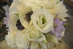 Bridal bouquet with anemone,lisianthus, scabiosa,brushing bride,sweetpea
