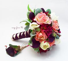 Tulips, calla lilies, hydrangea, roses, succulents and lambs ear create a vibrant and lush bouquet that can be part of your special day! I can create it for you as shown or customize it to fit your color scheme. We can work together to create a custom silk flower wedding package for your entire wedding party! This custom silk flower bridal bouquet is 9 in diameter and includes light coral-peach Real Touch roses, Real Touch deep plum calla lilies, Real Touch ivory tulips, silk burgundy…