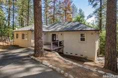 3187 Cedar Valley Ln, Placerville, CA 95667 — Nestled in the soaring pines this newer contemporary ranch styled home features all the living square footage on the entry level with an extra deep garage and basement below. A spacious front porch welcomes your friends and family to enjoy the natural setting. The covered rear porch is a terrific retreat spot. The beautifully appointed kitchen and great room concept is ready for entertaining. The spacious master suite is a real retreat with room…