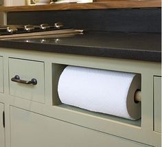 Kitchen Roll Paper Towel on DOwel in Kichen. Grey Kitchen Black Counter tops. *BAD LINK* CHANGE