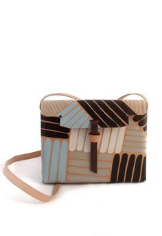 Eleganza bag - This colorful bag is part of the continued Drawing collection by Pendular Pocket. Each piece of the collection is specially hand-drawn and painted over natural leather in an artisanal fashion, making the piece one of a kind.