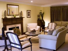 Traditional. Subtle furniture style defines the room that was designed to allow seating for large family gatherings. Solid, neutral fabric selections, mixed with a quiet stripe fabric, allow the room to feel welcoming, not crowded.