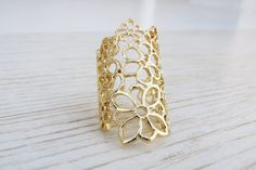 Check out this item in my Etsy shop https://www.etsy.com/listing/206785664/adjustable-gold-lace-ring-gold-cocktail
