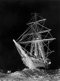 Photo of 'Endurance' lit by flares at night. Photo by Frank Hurley during Ernest Shackleton's Imperial Trans-Antarctic Expedition (1914-1916).