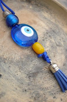 A Lucky Eye ornament against the evil eye! Made with Greek beads - glass & worry beads components- it is used as an ornament in the house; the car, or the boat Eye Jewelry, I Love Jewelry, Greek Blue, Greek Evil Eye, Hamsa Hand, Blue Eyes, Glass Beads, Beaded Bracelets, Boat