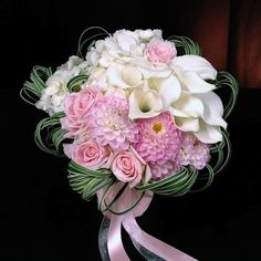 Pretty bouquet, color & component blocking design in white & pink flowers.
