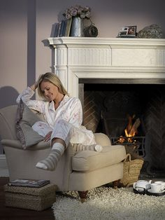 Pajamas and cocoa by the fire - looks like a cozy reading spot to me.