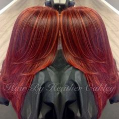 red layered hairstyle with orange highlights