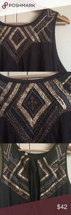 """Vintage FREE PEOPLE Beaded Flared Tie Tank Beautifully made with elegant and intricate beading. The bottom has pleats that flare the tank out when you move. Back has ties to adjust. Though it is a large it can fit many sizes. I'm typically a small and it works great on me. Material is 100% cotton. Measures about 19"""" from armpit to armpit. 23 inches in length from the top shoulder. Condition is like new. Free People Tops Tank Tops"""