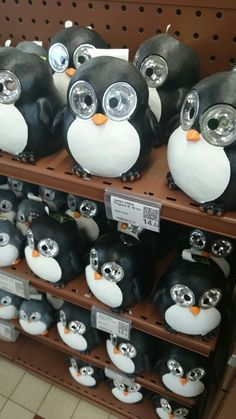 Solar Lamp Penguins. I can just imagine an army of these with glowing eyes in my front yard.
