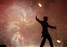 A performer participates in a two-day fire festival in Minsk, Belarus, ...