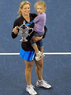 Kim Clijsters Celebrates with her Daughter (September 2010)  Tennis great Kim Clijsters celebrates her repeat US Open title by balancing a shiny trophy, and her then two-year-old, Jada, in her arms. Clijsters retired in 2007 in order to start a family, only to come back stronger than ever in 2009. Now, that's a champion mom!