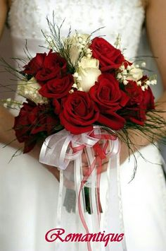 Elegant Winter Wedding Bouquet Featuring: Red Roses, White Roses, White Lily Of The Valley + Green Tree Fern Winter Foliage