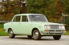 1965 Toyota Corona...bought for super cheap in 1974  (for under 350, I think.)  I think this was one of the first years of Toyota imports.  Ran it hard for 2 years until the auto trans finally died on me.