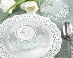 """Lace Exquisite Frosted-Glass Coasters The loveliness of lace is found on tabletops and wedding gowns. So you can grace your tables with its delicate auraand thank your guests with the beauty of lace, Kate Aspen has created these incomparable coasters, inspiring you to set a place for lace. Features and facts: •Two elegant, round, frosted-glass coasters with delicate, lace-inspired design •Coasters measure 4"""" in diameter •Gift presentation includes clear display gift box with wide…"""