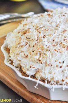 A sky-high banana cream pie made with a vanilla cream filling and topped with toasted coconut, this easy pie is sure to impress!