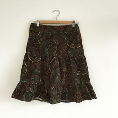 """Ann Taylor Loft cotton skirt Fun parsley design w/ dark brown background. 100% cotton corduroy. No lining. Zipper on the left side. Tag says size 0 but feels bigger like size 4 or 6. Measurement: 28"""" waist, 36"""" hips, 23"""" long. A great winter skirt. Ann Taylor Skirts A-Line or Full"""