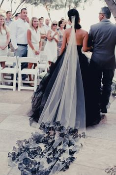 Black wedding dress with beautiful veil. I would love to have for my wedding one day...