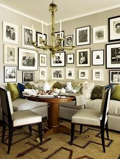 Love the mix of wide and no-so-wide mats, along with black and white gallery frames. Can't you just imagine the lively family meals that happen here?