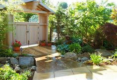 Garden. Exquisite Traditional Front Garden Design Ideas With Wooden Arbor Feat Gate And Natural Ornamental Tree Also Clean Light Brown Pathway Plus Rock Garden Treatment At Beautiful Landscapes For Houses. 14 Beautiful Landscapes For Houses Always Remind Us To Get Back To Nature