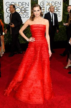 Allison Williams wearing an Armani Prive crimson red gown with fitted strapless bustier at the 72nd Annual Golden Globes