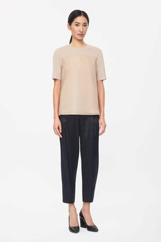 Made from crisp stretch poplin, this top has a contrast outer layer in sheer silk-mix organza. Slightly oversized, it is a flared A-line shape with dropped shoulder seams, half sleeves and a hidden zip fastening along the back.