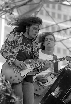 "Gary Rossington & Allen Collins (Lynyrd Skynyrd). These guys wrote riffs that make you wanna move your feet. I pick ""Call Me the Breeze"" every time I use a juke box."