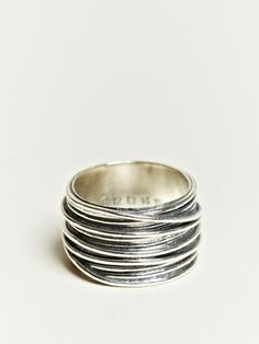 i think this would be really easy - do a normal plain silver ring, wrap wire around and solder. sweet.