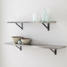 two of these with layered espresso stain frames.  Would be great with the stainless floor lamp Stainless Steel Shelf + Basic Brackets #westelm