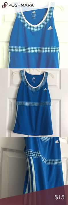 """Adidas Tank with Built in Bra Adidas Tank with Built in Bra. Size Large. 91% Polyester, 9% Spandex. Length from one shoulder down is approximately 25"""". adidas Tops Tank Tops"""
