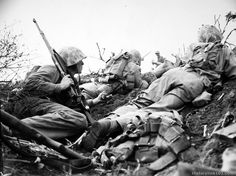 Shot of men moving up to front lines, others returning. Iwo Jima - February 27, 1945